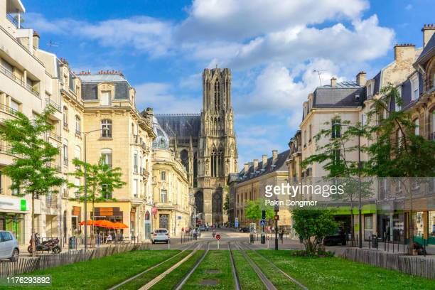 city street amidst old buildings at reims city - reims stock pictures, royalty-free photos & images