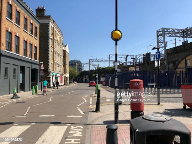 city street and buildings against sky - shoreditch stock photos and pictures