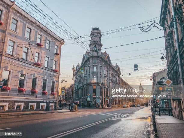 city street and buildings against sky - russia stock pictures, royalty-free photos & images