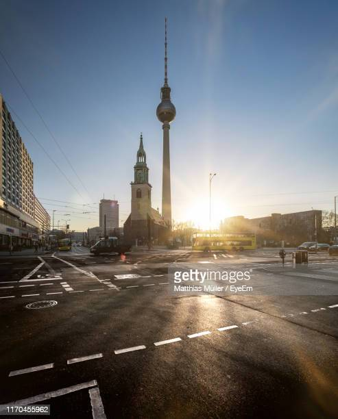 city street and buildings against sky - berlin stock-fotos und bilder