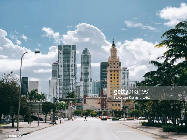 city street and buildings against sky - miami stock pictures, royalty-free photos & images