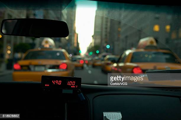 City street and fare meter from inside taxi