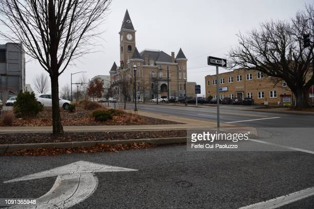 city street and road sign at fayetteville, arkansas, usa - arkansas stock photos and pictures