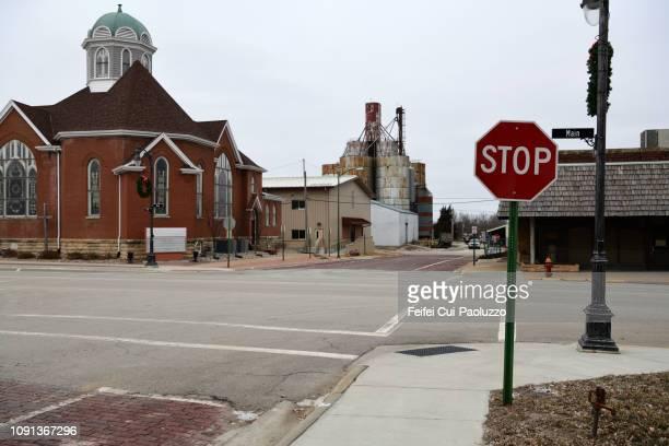 city street and stop road sign at sabetha, kansas, usa - kansas stock pictures, royalty-free photos & images