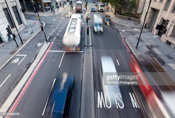 city street and vehicles, london, uk - driving stock pictures, royalty-free photos & images