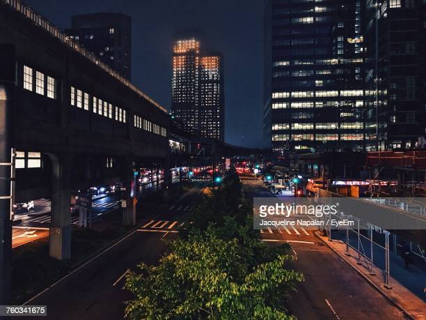 city street at night - long island city stock photos and pictures