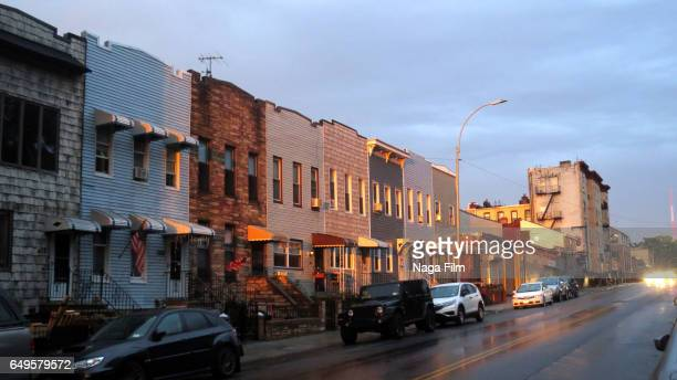 city street at sunset in brooklyn new york. - brooklyn new york stock pictures, royalty-free photos & images