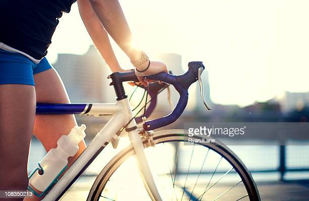 city street bike rider - racing bicycle stock pictures, royalty-free photos & images