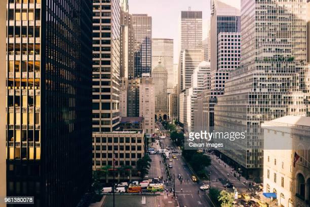city street by modern buildings - パークアベニュー ストックフォトと画像