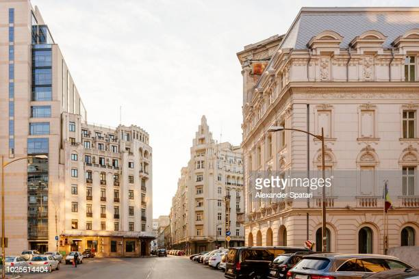 city street in bucharest old town with historical buildings - bucharest stock pictures, royalty-free photos & images