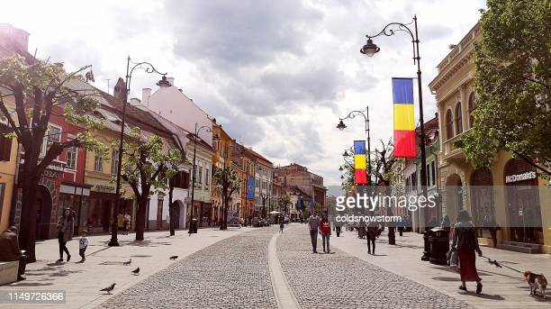 city street in centre of sibiu, transylvania, romania - sibiu stock photos and pictures
