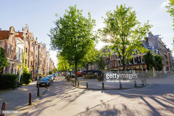 City street in Jordaan district in Amsterdam during sunset, Amsterdam, Netherlands