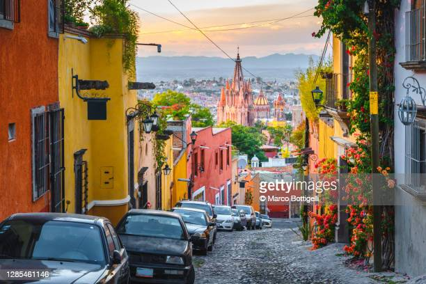 city street in san miguel de allende, mexico - international landmark stock pictures, royalty-free photos & images