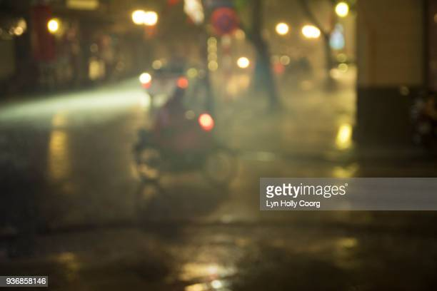 city street in the rain at night - lyn holly coorg stock photos and pictures