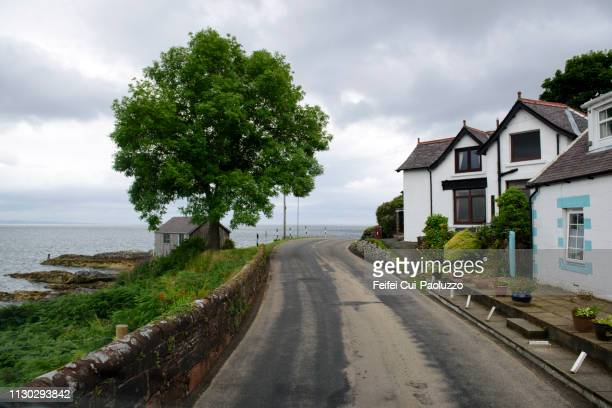 city street of corrie, arran, scotland - town stock pictures, royalty-free photos & images