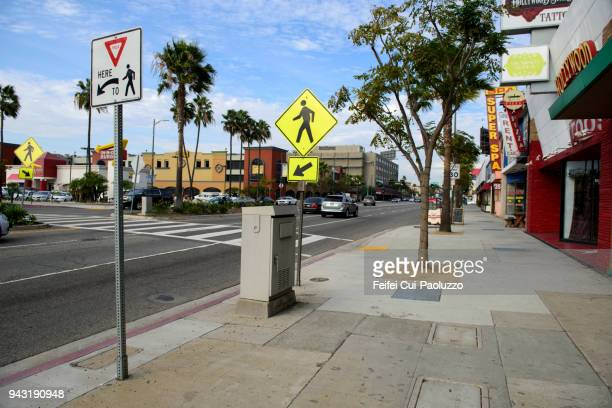 an airplane flying through street of westchester, los angeles airport, california, usa - pedestrian crossing sign stock photos and pictures