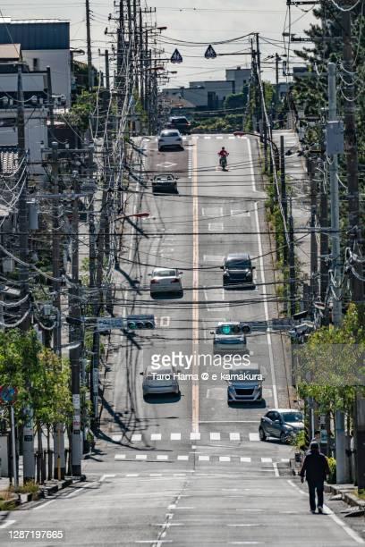 city street on residential hill in kanagawa prefecture of japan - taro hama ストックフォトと画像