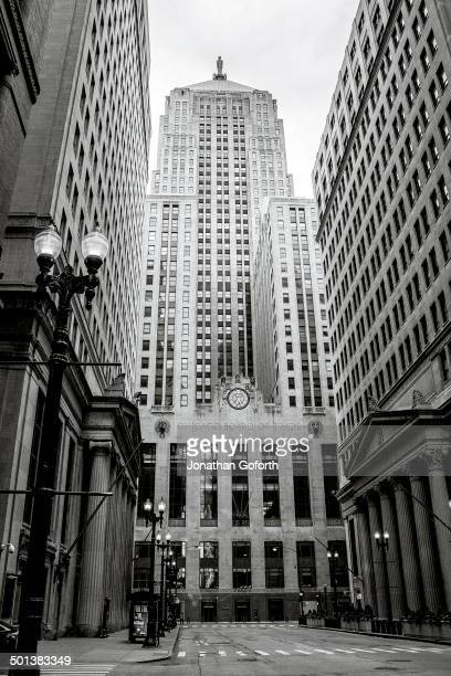 CONTENT] A city street shot with the Chicago Board of Trade at the end of the street