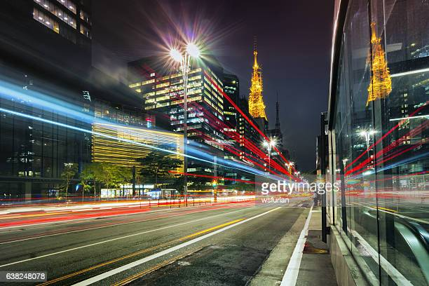 city street showing traffic flow lines with long exposure - são paulo stock pictures, royalty-free photos & images