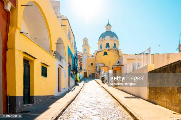 city street to santa maria delle grazie church, procida island, italy. - italy stock pictures, royalty-free photos & images