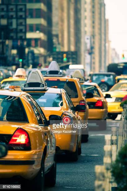 city street traffic, new york, usa - taxi stock pictures, royalty-free photos & images