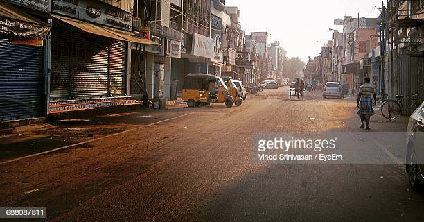city street with buildings in background - chennai stock pictures, royalty-free photos & images