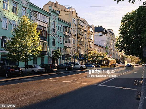 city street with buildings in background - kiev stock pictures, royalty-free photos & images