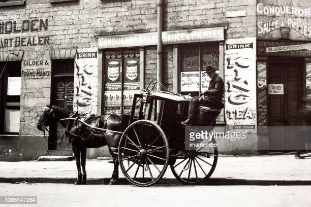 city street with horse carriage and rider 1924, old photo - animal powered vehicle stock photos and pictures