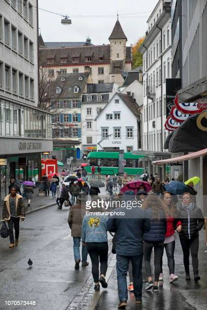 city street with people on a rainy day,basel. - emreturanphoto stock pictures, royalty-free photos & images