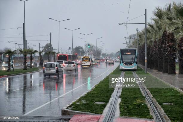 city street with traffic and cable cars. - emreturanphoto stock pictures, royalty-free photos & images
