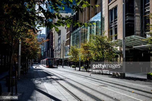 city street with tram tracks and shops, sydney, australia - sydney stock pictures, royalty-free photos & images