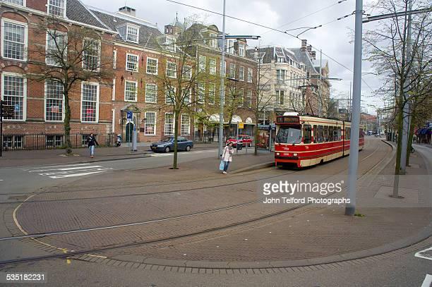 city streets and trolley in the hague. - den haag stock-fotos und bilder
