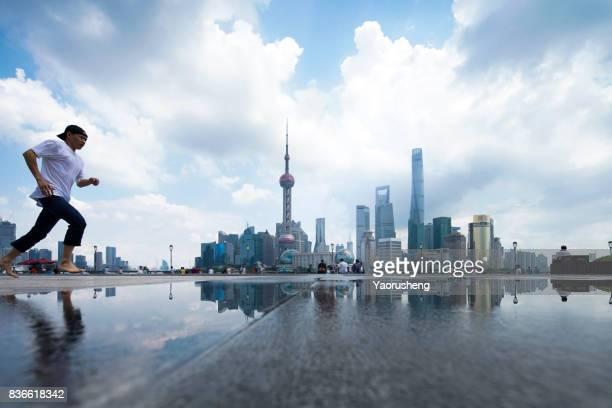 City success urban man jumping of joy in Shanghai
