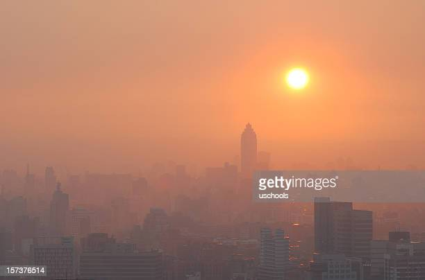 city sunset in smog - global warming stock pictures, royalty-free photos & images