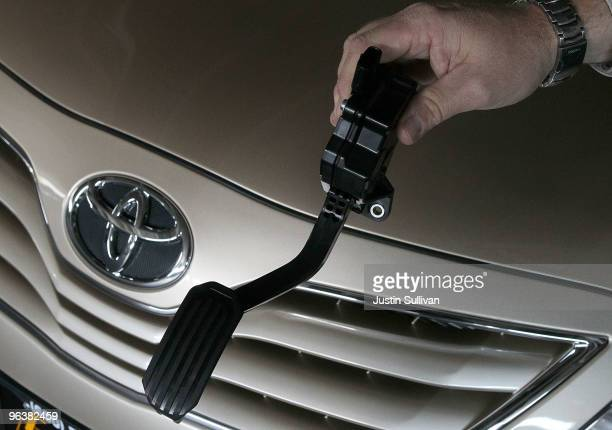 City Toyota service manager Jim Lasseter holds a recalled accelerator pedal next to a brand new Toyota Camry that is scheduled to be fixed February 3...
