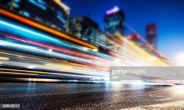 city traffic at night - motion blur stock photos and pictures