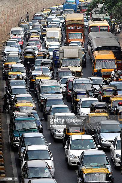 City traffic moves on a busy street in Mumbai India on Thursday Nov 29 2007 India's economy grew last quarter at the slowest pace since 2006...