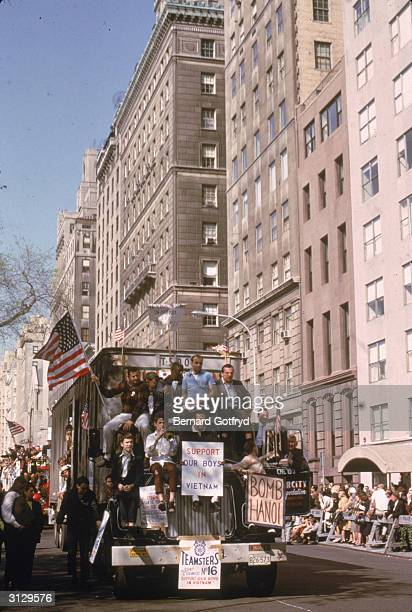 City Transportation Union members hold signs and flags as they ride on the outside of a truck during a proViet Nam war demonstration New York New...