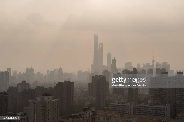 city under siege, shanghai air pollution - carbon dioxide stock photos and pictures