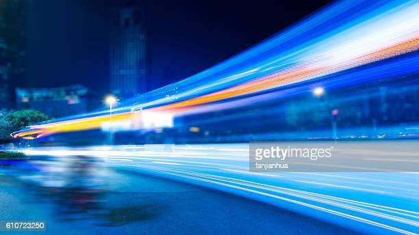 city view at night with traffic and trail light - in a row stock pictures, royalty-free photos & images