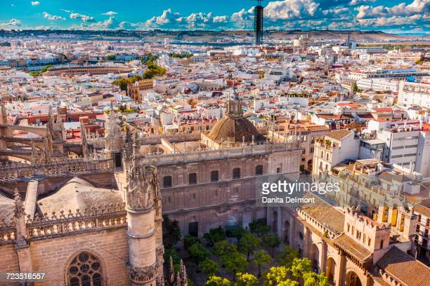 City View from Giralda Spire Bell Tower on Orange Garden and Seville Cathedral, Bull Ring in distance, Seville, Andalusia, Spain