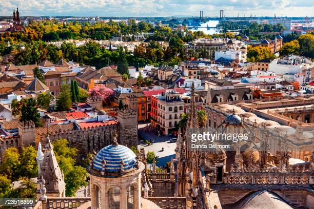 City View from La Giralda Spire Bell Tower of Seville Cathedral on Plaza and Alcazar, River Guadalquivir in background, Seville, Andalusia, Spain