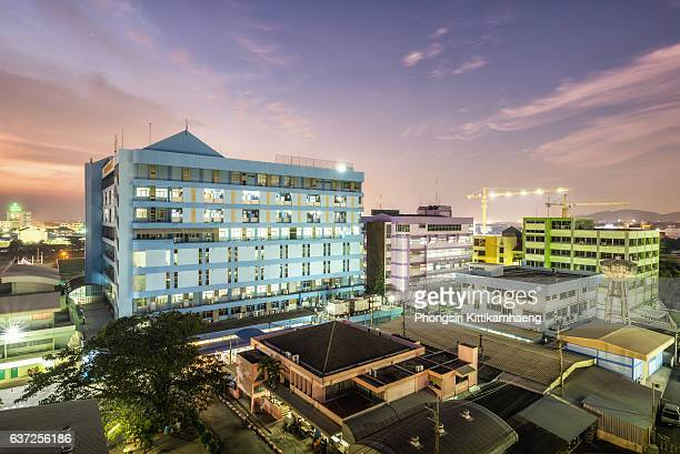 city view twilight of chonburi hospital - medical building stock pictures, royalty-free photos & images