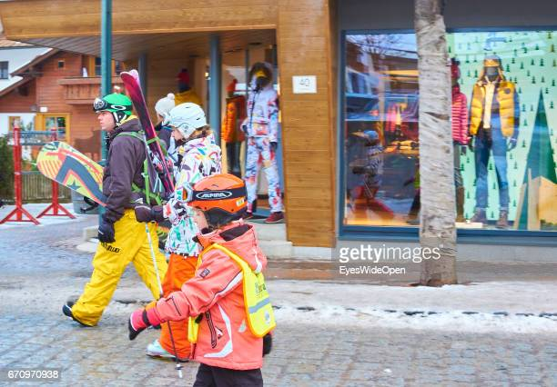 City view with tourists skier shopping area on January 8 2014 in StAnton Tyrol Austria