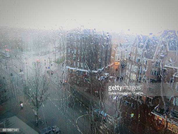 City Viewed Through From Wet Window