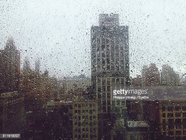 City viewed through window in rain