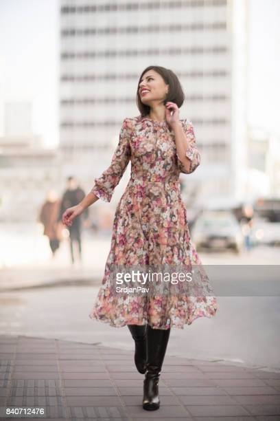 city walk - floral pattern dress stock pictures, royalty-free photos & images