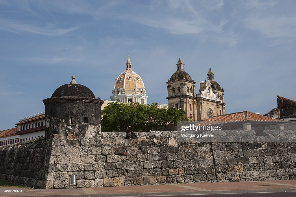 City wall of the old walled city of Cartagena, Colombia with San Pedro Claver church in background.