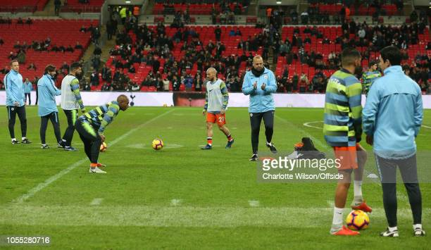 City warm up on a worn and NFL marked patch of pitch during the Premier League match between Tottenham Hotspur and Manchester City at Wembley Stadium...