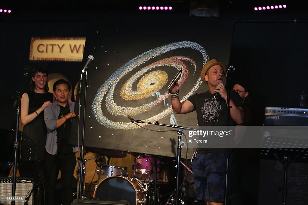 City Winery owner Michael Dorn auctions off artwork created onstage by Tara C. Lobsang perform at the Everest Awakening: A Prayer for Nepal and Beyond Benefit show at City Winery on May 17, 2015 in New York City.